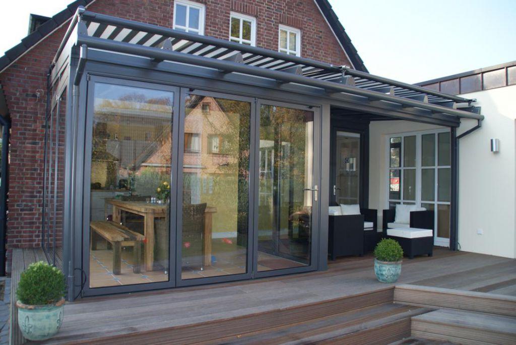 Solarlux Wintergarten in Hamburg-Solldorf mit rundum Glas-Faltwänden