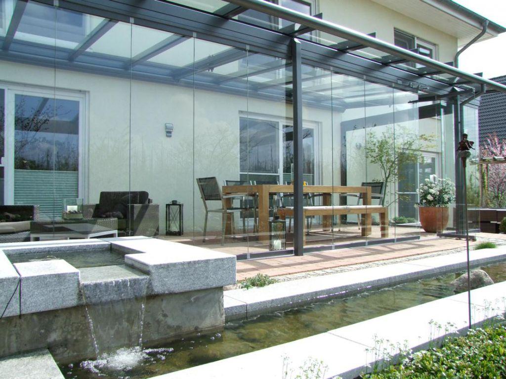 Blick in das Solarlux Glashaus Atrium mit SL25 Schiebe-Dreh-System in Ellerhop