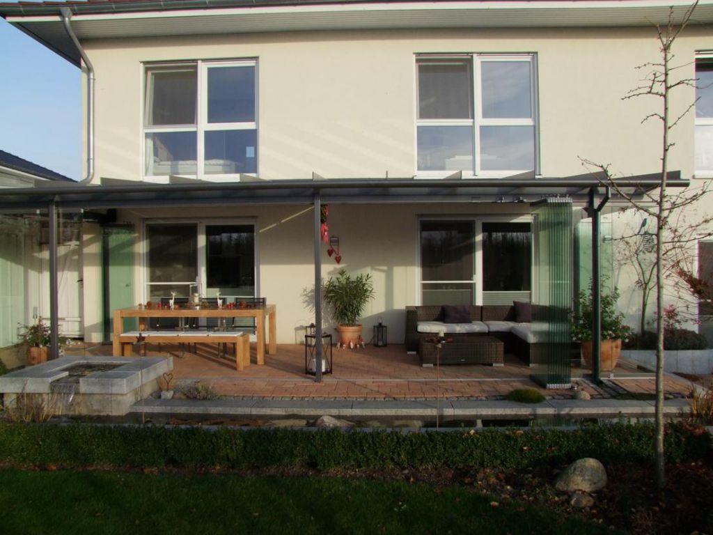 Solarlux Glashaus Atrium mit SL25 Schiebe-Dreh-System in Ellerhop mit geöffneten Wänden